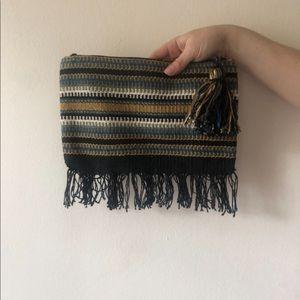 Blue striped woven clutch